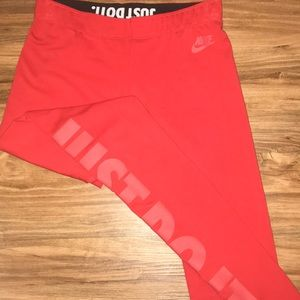 Red Nike leggings with just do it written on leg
